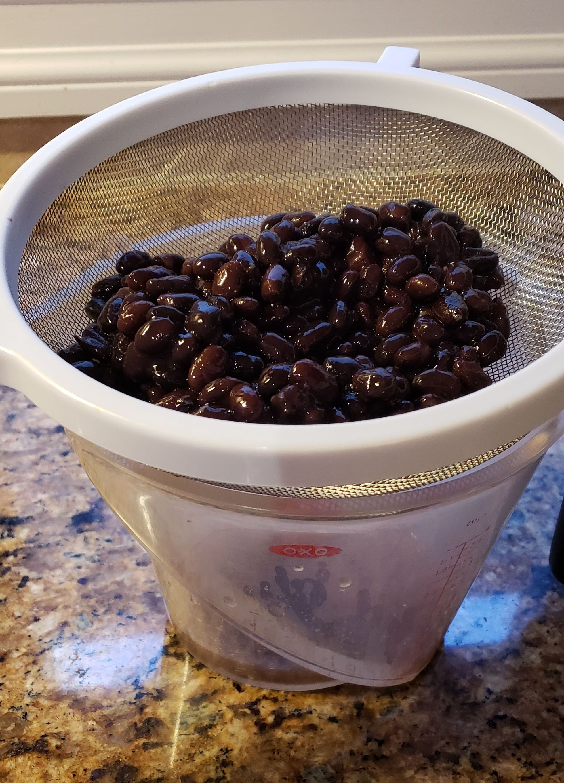 straining black beans for moros